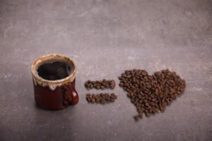 Coffee Cup and Coffee Beans in the Shape of Heart